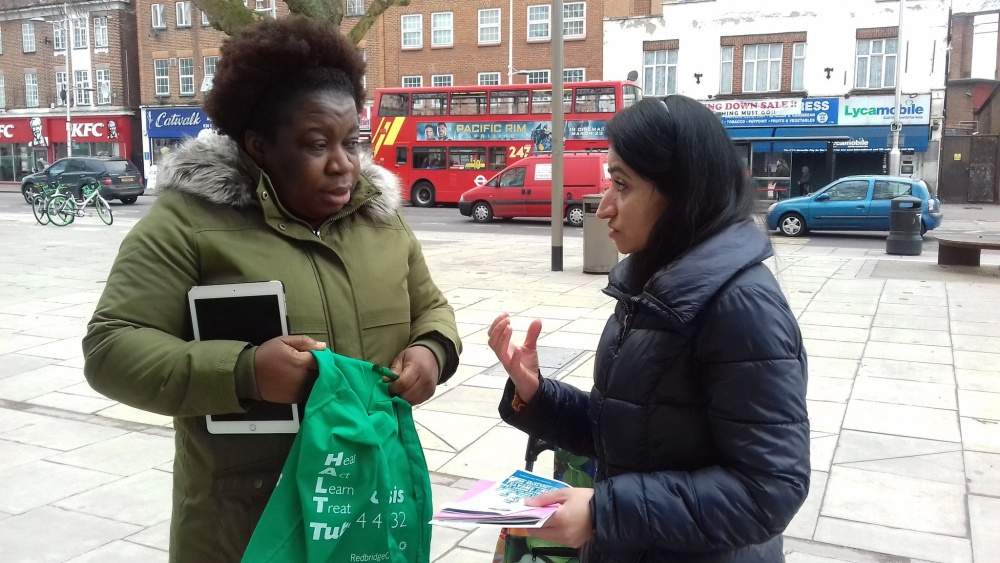Redbridge Health and Wellbeing Buddy talking to a member of the public