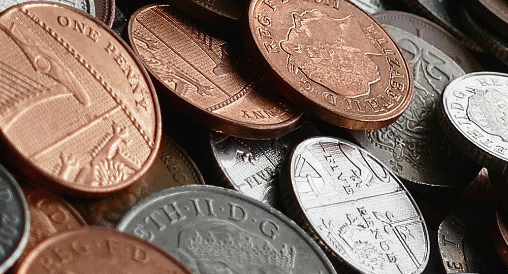A large picture of coins, illustrating a funding drive.